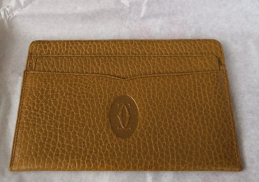 Cartier yellow leather cartera billetero tarjetero amarillo 8×12 cm.